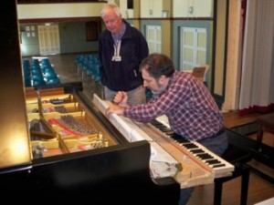 Ari from Theme and Variation watched by Ian Greig our piano tuner